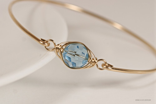 14k yellow gold filled wire wrapped bangle bracelet with aquamarine blue Swarovski crystal handmade by Jessica Luu Jewelry