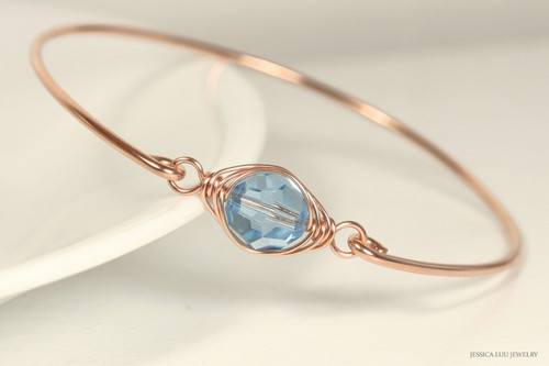 14k rose gold filled wire wrapped bangle bracelet with aquamarine blue crystal handmade by Jessica Luu Jewelry