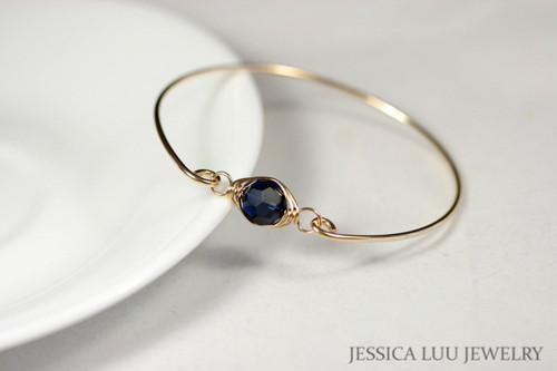 14k yellow gold filled wire wrapped bangle bracelet with dark indigo navy blue Swarovski crystal handmade by Jessica Luu Jewelry