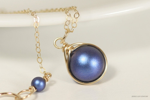 14K yellow gold filled wire wrapped iridescent dark blue Swarovski pearl solitaire pendant on chain necklace handmade by Jessica Luu Jewelry