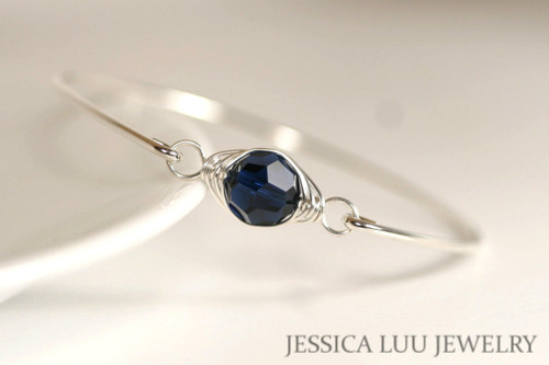 Sterling silver wire wrapped bangle bracelet with dark indigo navy blue Swarovski crystal handmade by Jessica Luu Jewelry