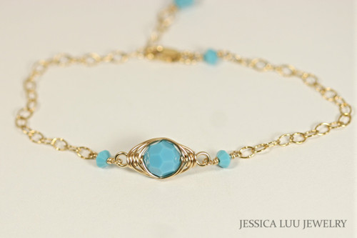 14k yellow gold filled wire wrapped chain bracelet with turquoise blue faceted Swarovski crystals handmade by Jessica Luu Jewelry