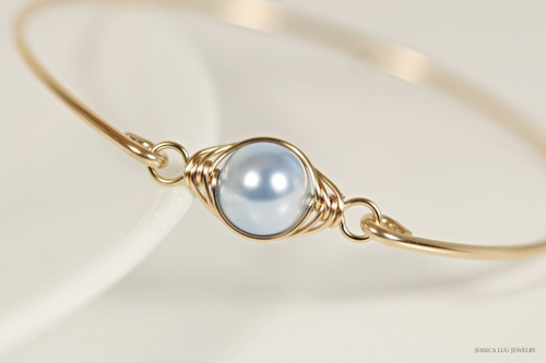 Handmade 14k yellow gold filled wire wrapped bangle bracelet with light blue Swarovski pearl by Jessica Luu Jewelry