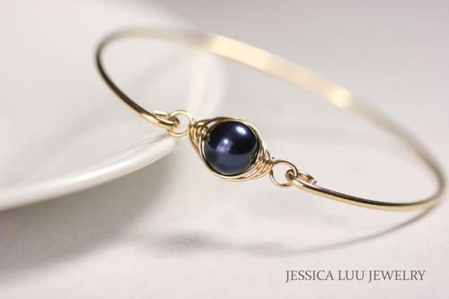 14k yellow gold filled wire wrapped bangle bracelet with dark navy night blue Swarovski pearl handmade by Jessica Luu Jewelry