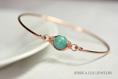 14k rose gold filled wire wrapped bangle bracelet with jade green Swarovski pearl handmade by Jessica Luu Jewelry