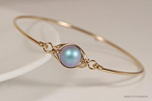 14K yellow gold filled wire wrapped bangle bracelet with iridescent light blue Swarovski pearl handmade by Jessica Luu Jewelry