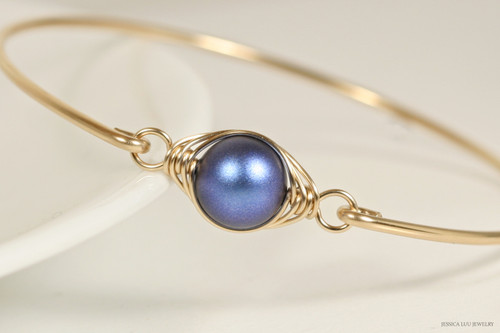 14K yellow gold filled herringbone wire wrapped iridescent dark blue Swarovski pearl solitaire bangle bracelet handmade by Jessica Luu Jewelry