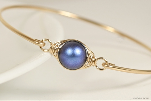 14K yellow gold filled herringbone wire wrapped iridescent dark blue Swarovski pearl solitaire bangle bracelet handmade by Jessica Luu Jewelry