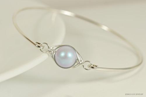 Sterling silver wire wrapped iridescent dreamy blue Swarovski pearl solitaire bangle bracelet handmade by Jessica Luu Jewelry