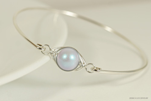 Sterling silver wire wrapped iridescent dreamy blue pearl solitaire bangle bracelet handmade by Jessica Luu Jewelry
