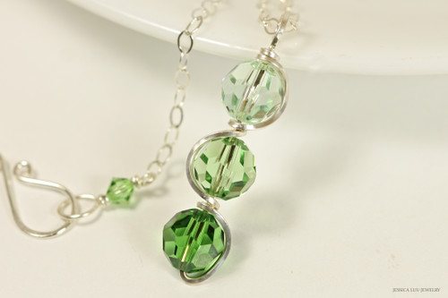 Sterling silver wire wrapped green ombre pendant on chain necklace with chrysolite, peridot, and fern green crystals handmade by Jessica Luu Jewelry