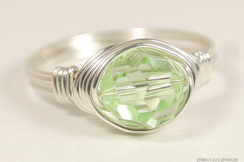 Sterling silver wire wrapped light green chrysolite crystal solitaire ring handmade by Jessica Luu Jewelry