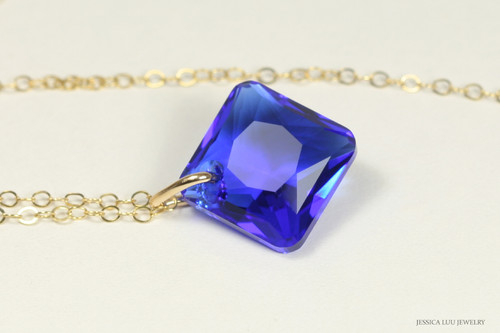 14K yellow gold filled chain necklace with majestic blue crystal pendant handmade by Jessica Luu Jewelry