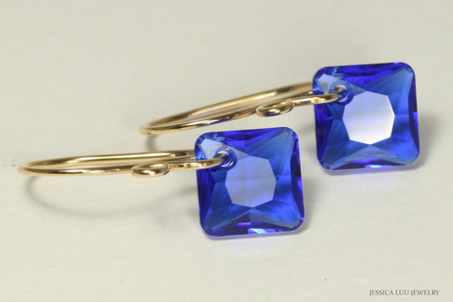 14K gold filled earrings with majestic blue crystal dangles handmade by Jessica Luu Jewelry
