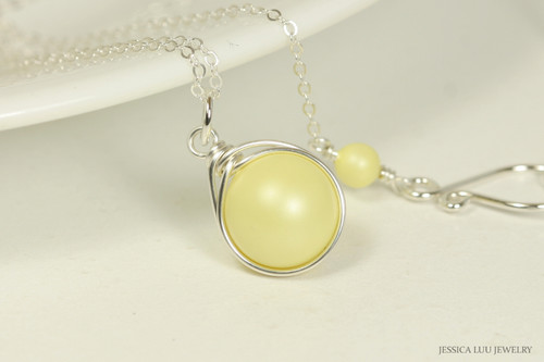 Sterling silver wire wrapped pastel yellow pearl solitaire necklace handmade by Jessica Luu Jewelry
