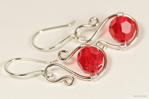 Sterling silver wire wrapped cherry red light siam Swarovski crystal dangle earrings handmade by Jessica Luu Jewelry