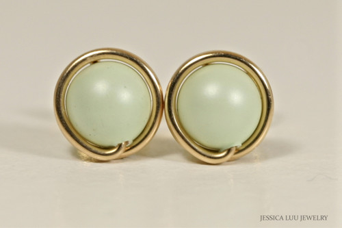 14K yellow gold filled wire wrapped pastel light green Swarovski pearl stud earrings handmade by Jessica Luu Jewelry