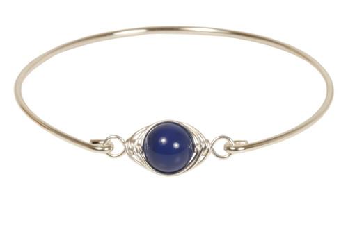 Sterling silver wire wrapped dark lapis blue bangle bracelet handmade by Jessica Luu Jewelry