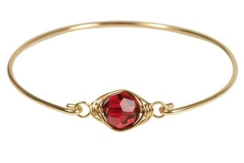 14k yellow gold filled wire wrapped bangle bracelet with scarlet red Swarovski crystal handmade by Jessica Luu Jewelry
