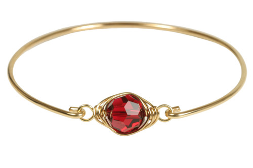 14k yellow gold filled wire wrapped bangle bracelet with scarlet red crystal handmade by Jessica Luu Jewelry