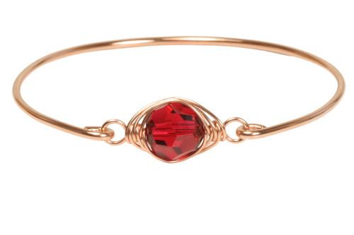 14k rose gold filled wire wrapped bangle bracelet with scarlet red Swarovski crystal handmade by Jessica Luu Jewelry