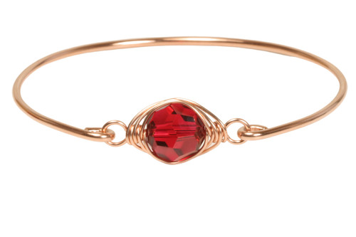 14k rose gold filled wire wrapped bangle bracelet with scarlet red crystal handmade by Jessica Luu Jewelry