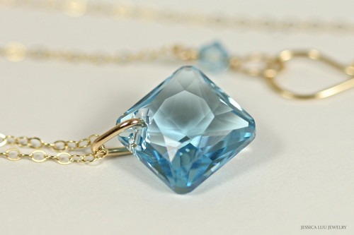 14K yellow gold filled aquamarine blue Swarovski crystal pendant on chain necklace handmade by Jessica Luu Jewelry