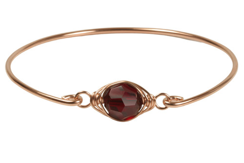 14k rose gold filled wire wrapped bangle bracelet with garnet red siam crystal handmade  by Jessica Luu Jewelry