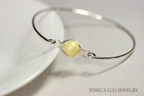 handmade sterling silver wire wrapped bangle bracelet with pastel yellow Swarovski pearl by Jessica Luu Jewelry