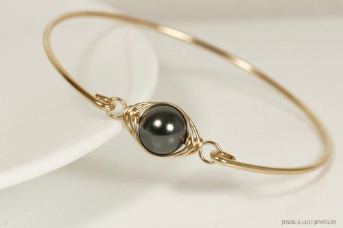14K yellow gold filled wire wrapped bangle bracelet with black Swarovski pearl handmade by Jessica Luu Jewelry