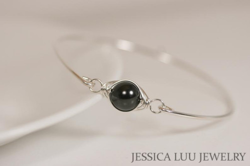 Sterling silver wire wrapped bangle bracelet with black Swarovski pearl handmade by Jessica Luu Jewelry