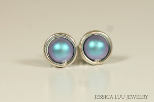 Sterling silver wire wrapped stud earrings with iridescent light blue Swarovski pearls handmade by Jessica Luu Jewelry