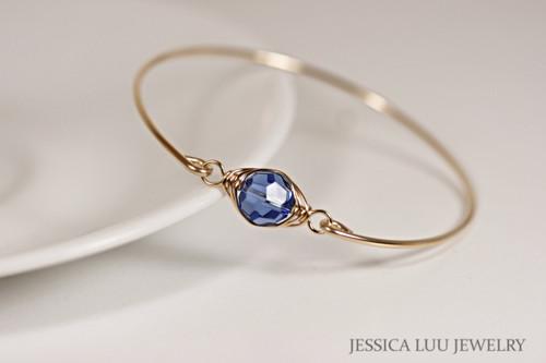 14k yellow gold filled wire wrapped bangle bracelet with sapphire blue Swarovski crystal handmade by Jessica Luu Jewelry