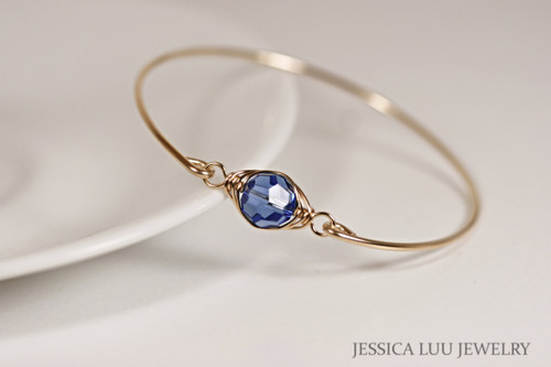 14k yellow gold filled wire wrapped bangle bracelet with sapphire blue crystal handmade by Jessica Luu Jewelry