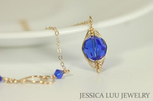 14K yellow gold filled herringbone wire wrapped majestic cobalt blue Swarovski crystal pendant on chain necklace handmade by Jessica Luu Jewelry