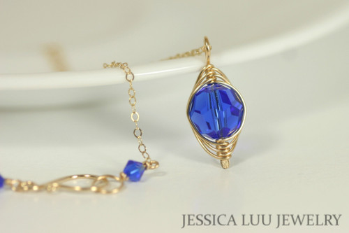 14K yellow gold filled herringbone wire wrapped majestic cobalt blue crystal pendant on chain necklace handmade by Jessica Luu Jewelry