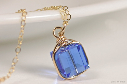 14K yellow gold filled wire wrapped sapphire blue Swarovski crystal cube pendant on chain necklace handmade by Jessica Luu Jewelry