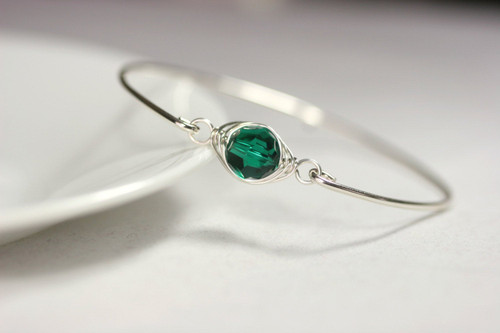 Sterling silver wire wrapped bangle bracelet with emerald green Swarovski crystal handmade by Jessica Luu Jewelry