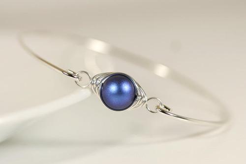 Sterling silver wire wrapped bangle bracelet with iridescent dark blue Swarovski pearl handmade by Jessica Luu Jewelry