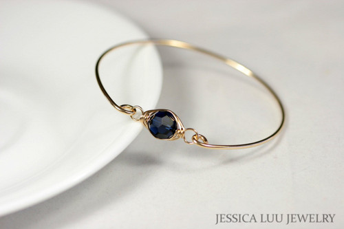 14k yellow gold filled wire wrapped bangle bracelet with dark indigo navy blue Swarovski crystal handmade by Jessica Luu Jewelry