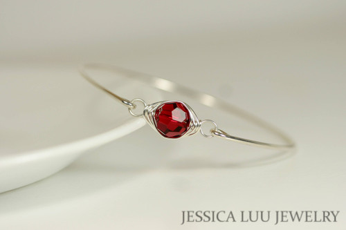 Sterling silver wire wrapped bangle bracelet with scarlet red Swarovski crystal handmade by Jessica Luu Jewelry