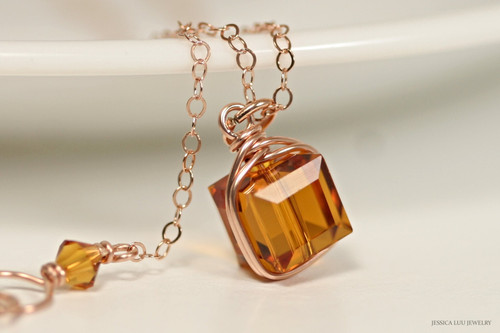 14k rose gold filled wire wrapped pendant on chain necklace with orange topaz Swarovski crystal cube handmade by Jessica Luu Jewelry