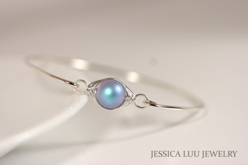 Sterling silver wire wrapped bangle bracelet with iridescent light blue Swarovski pearl handmade by Jessica Luu Jewelry