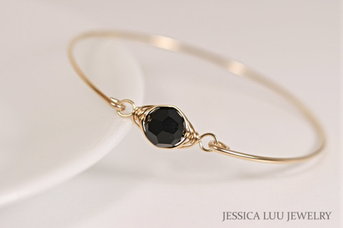 14k yellow gold filled wire wrapped bangle bracelet with jet black Swarovski crystal handmade by Jessica Luu Jewelry
