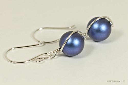 Sterling silver wire wrapped iridescent dark blue Swarovski pearl dangle earrings handmade by Jessica Luu Jewelry
