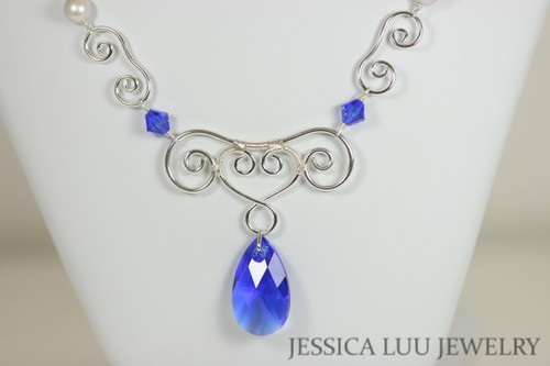 Sterling silver wire wrapped necklace with majestic blue Swarovski crystal pear pendant and iridescent dove grey Swarovski pearls handmade by Jessica Luu Jewelry