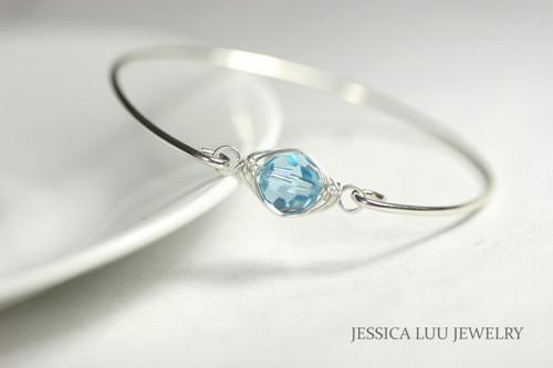 Sterling silver wire wrapped bangle bracelet with aquamarine Swarovski crystal handmade by Jessica Luu Jewelry