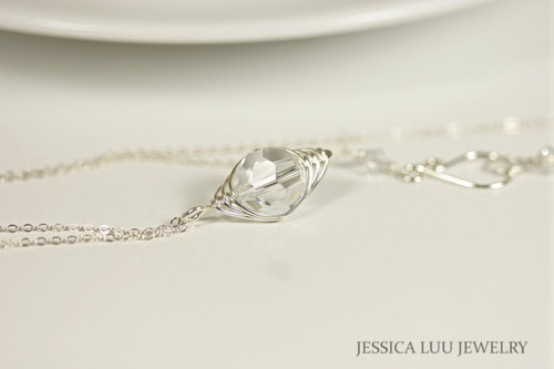 Sterling silver herringbone wire wrapped clear Swarovski crystal pendant on chain necklace handmade by Jessica Luu Jewelry
