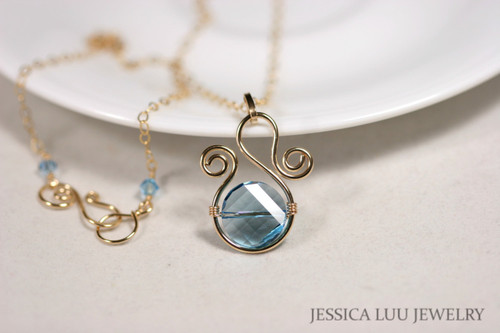14K yellow gold filled wire wrapped aquamarine blue Swarovski crystal pendant on chain necklace handmade by Jessica Luu Jewelry