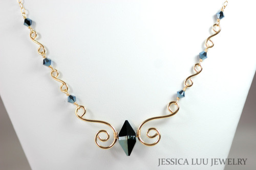 14K yellow gold filled wire wrapped metallic blue Swarovski crystal double spike necklace handmade by Jessica Luu Jewelry